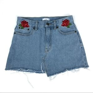 Tna Cut Off Mini Denim Skirt With Floral Accents